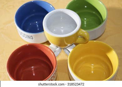 colored coffee cup and mug for a game of shapes and colors