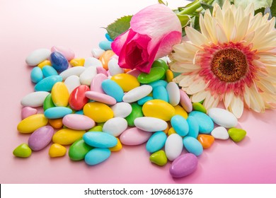 colored confetti on pink background