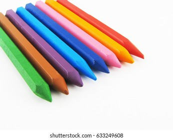 Colored crayons isolated.