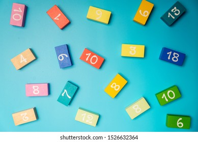 colored cubes with numbers lie on a blue background