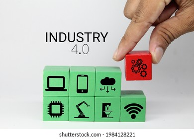 colored cubes with technology items and the word Industry 4.0