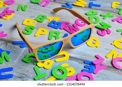 colored cutout letters with sunglasses