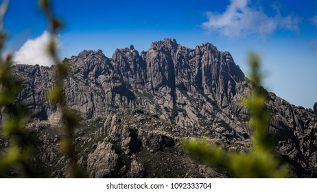 Colored detail of the texture of the rock mountain called Agulhas Negras framed by the region's nature in blur.