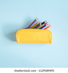 Colored different school supplies on soft  blue paper background. Back to school background. Flat lay, top view, copy space