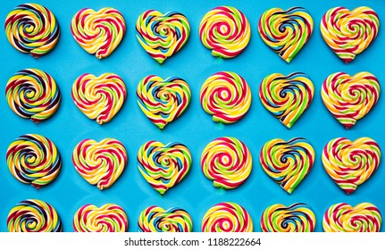 colored, different sweets, lollipops on a blue background. Top view, sweets concept