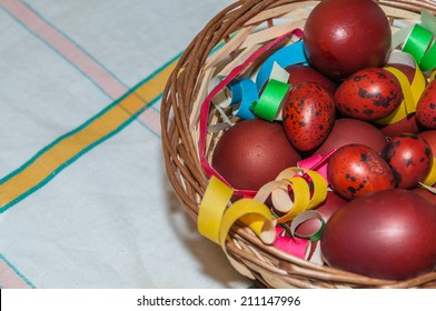 Colored easter eggs in brown basket
