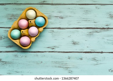 Colored Easter eggs of sugar on wooden background
