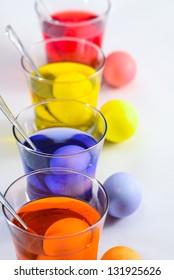Colored eggs in glass