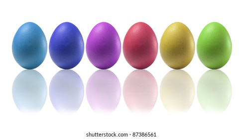 Colored eggs on a white background with reflections on the basis
