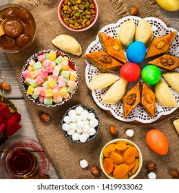 Colored eggs and sweet pastry for Nawruz Holiday in Azerbaijan. Selective focus.