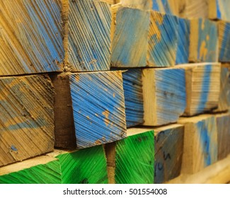 Colored ends of stacked lumber. Delhi, New York.