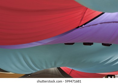 colored fabrics, draping the ceiling of the tent, closeup