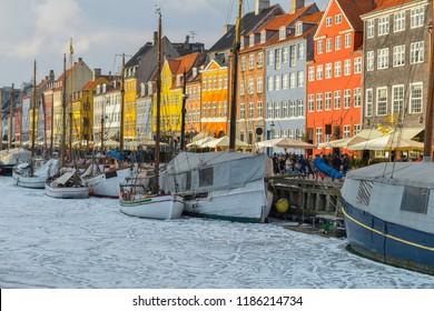 Colored facades of Nyhavn in Copenhagen in Denmark in winter