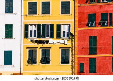 colored facades to village in Liguria italy