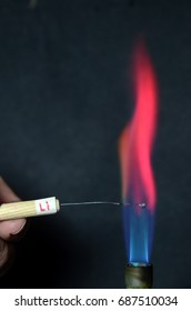 Colored fire caused by an element. Lithium causes a carmine red color.