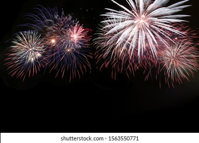 Colored fireworks in the dark sky