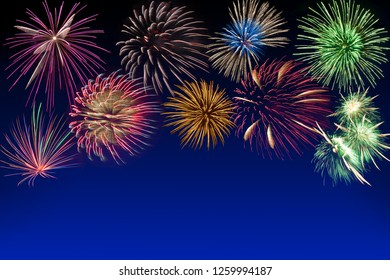 Colored fireworks on dark blue background