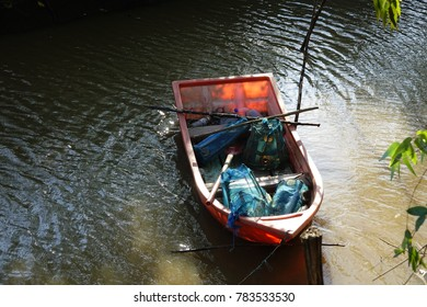 Colored fishing boat in canal.