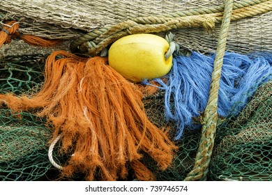 Colored fishing nets with ropes and net float.