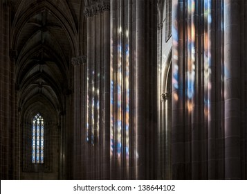 Colored flecks from windows on the columns of the Batalha Santa Maria da Vitoria Dominican abbey, Portugal