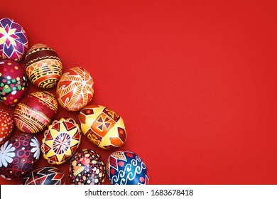 colored, floral easter eggs on a red background, place for text. Easter holiday. Easter decoration