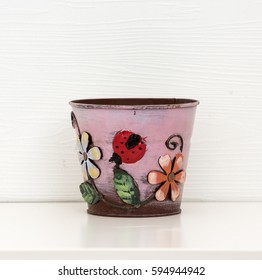 Colored flower pot on white ground