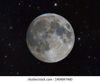 Colored full moon with deep sky stars. Original image captured from earth with amateur telescope.