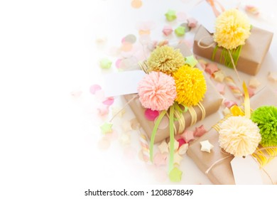 Colored gift boxes with colorful ribbons and pompon. white background