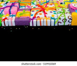 Colored gift boxes with colorful ribbons. Gifts for Christmas or a birthday.