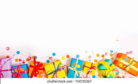 Colored gift boxes with colorful ribbons white background.Gifts or a birthday.