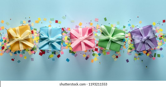 Colored gift boxes and confetti for birthday or Christmas