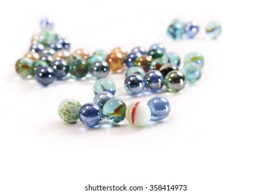 Colored glass balls on a white background