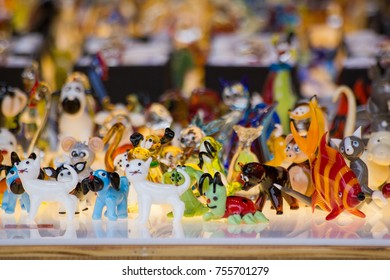 Colored glass figurines in shape of cat and dog and fish and lady bug