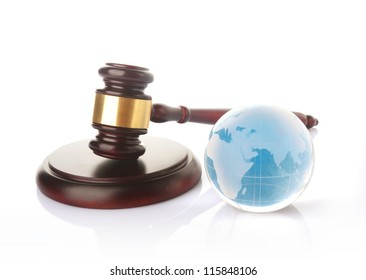 a colored globe with brown gavel on white background