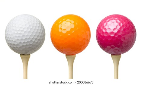 Colored golf balls on tee isolated on white background