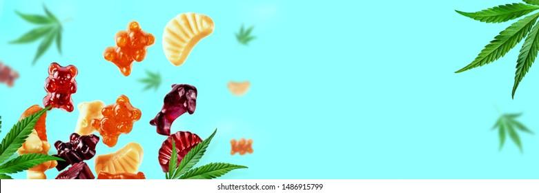 Farbige Gummis fliegen mit Cannabisblättern. Süßigkeiten mit CBD-Öl THC kauen