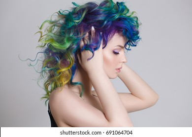 Colored hairs. Portrait of beautiful women with flying hairs and rhinestones . Ombre. Gradient