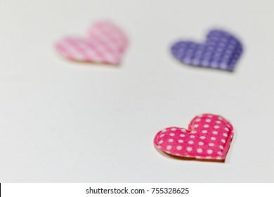 Colored hearts with white background