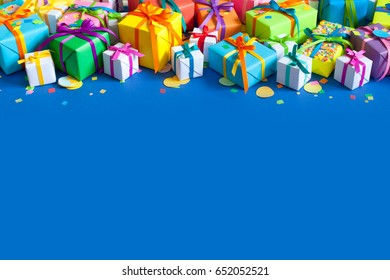 Colored holiday gifts. Blue background.