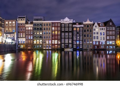 Colored homes on the water in Amsterdam