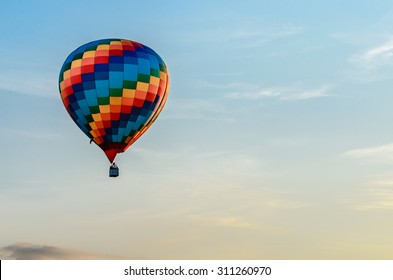Colored hot air balloon flying in the blue sky