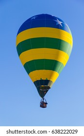 Colored hot air balloon flying in a blue sky