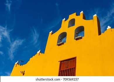 Colored houses and buildings over a blue sky in Campeche, Mexico.