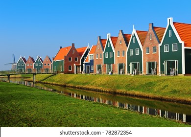 Colored houses of marine  park in Volendam reflected in the water, The Netherlands