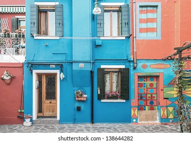 The colored houses on the shore of the channel on Burano - Venice, Italy