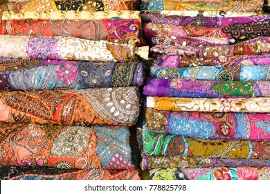 Colored Indian cotton bedspreads, beaded and embroidery at the market in Anjuna in North Goa.India