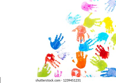Colored kids handprints on white background with blank space for text. Top view, flat lay.