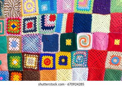Colored knitted carpet textile background