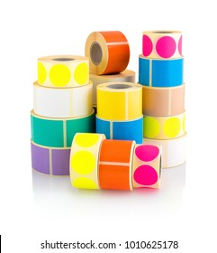 Colored label rolls isolated on white background with shadow reflection. Color reels of labels for printers. Labels for direct thermal or thermal transfer printing. Square and circle labels background