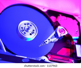 Colored lighting and selective focus make for an interesting inside view of a mass storage device.